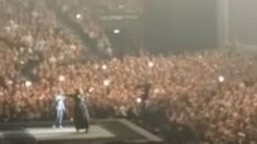 The moment an Adele fan gets up onto the stage during her concert in Belfast and proposes to her boyfriend.