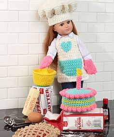 """Crochet a wonderful outfit for your 18"""" doll to wear while baking a colorful cake and cherry pie. This fun set includes apron, hat, oven mitts, mixing bowl, cake and pie. This is perfect for imaginary play and young kitchen helpers!"""