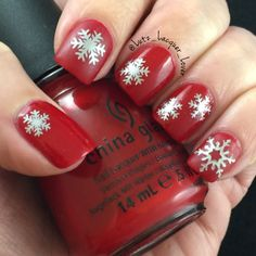 I wore my turkey nails for an entire week! Crazy!! So this is my first winter mani . Super simple China Glaze High Roller and snowflake stickers (from their awesome stencils) from @whatsupnails. My index and pinky nails art matte.  My topcoat is always HKGirl from Glisten&Glow. #GlistenandGlow ❤️. #diynails #nailart #polishaddict  #naturalnails #christmasnailart #chinaglaze #winternails #christmasnails #snowflakenails #chinaglaze #chinaglazeofficial