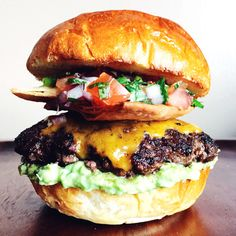 This burger solves the eternal bar food dilemma of burger or nachos: The answer is now always BOTH. Click here for the recipe.   - Delish.com