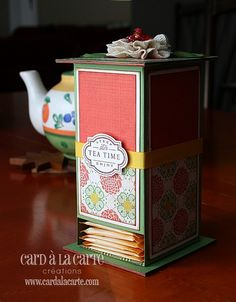 Tea bag dispenser.  Nice gift idea. I think you can take a cracker box, and make 2 cardboard square ends to make this, then find decorative templates for the box to making it look gorgeous.