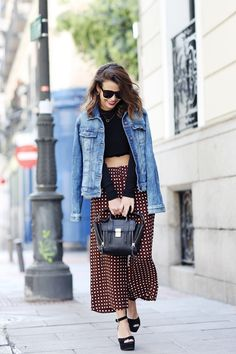 Black crop top and printed pants topped off with a classic denim jacket via CollageVintage.