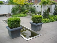 Kleine strakke tuin twee onder één kap