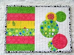 mug rug scrappy.   What a great way to use up scraps, practice free motion and something practical from it.