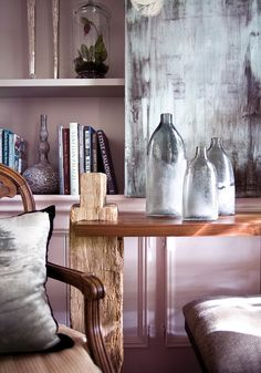 lovely grey textures: wall/painting(?), vases, cushion