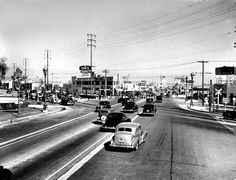 The intersection of Wilshire and Santa Monica Blvd c.1938. These street photos are some of my favorites!    Hollywood Historic Photos