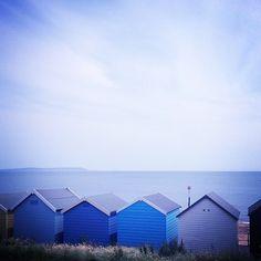 blue and white: the inspiration behind chartwellandg, the British luxury resort wear brand. Dorset beach hut blues