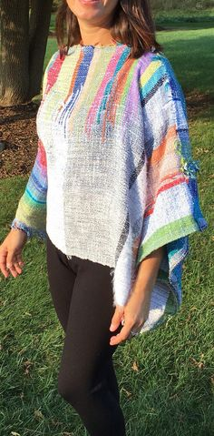 Wear this front or back, unique design on each side. Primarily cotton fibers, one size fits most. Loose and comfortable to wear, great over a tank, tee or blouse, stitch so has loose wearing sleeve. Great soft summer colors. Saori weaving is a Japanese free style art form of weaving. The