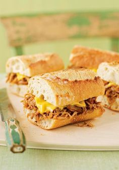 Pulled Chicken Sandwiches -- Ready in less than 30 minutes time, chicken thighs take their cue (or is it BBQ?) from pork and get fork-tender, shredded and piled onto a crunchy sandwich roll.