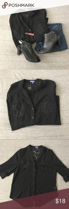 Black Button-Up Blouse with Embroidered Flowers The back also has buttons, but does not button down. Sheer material. Bluebell Tops Button Down Shirts