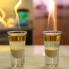Layered shooters don't come much prettier than these Hot Apple Pie Shots.These (literally) flaming shots mix up Irish cream, Goldschläger, and 151 proof rum, and will get you tipsy so quick you'll be craving some real hot apple pie in a matter of seconds. Booze Drink, Fun Drinks, Yummy Drinks, Alcoholic Drinks, Shots Drinks, Cocktails, Mixed Drinks, Cocktail Recipes, Beverages