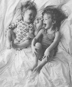 siblings laughing in bed