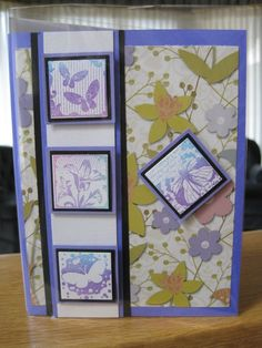 Card stamped using Kaleidacolor ink on inchies layered on punched squares & border with printed paper background