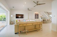 Coastal living area ~ Lazy Tree luxury villa vacation rental in Cape Coral ~ Interior design by Julie Kuntz, Robb & Stucky Naples