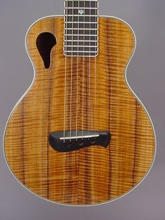 Tacoma Papoose. This small guitar has to be tuned higher than normal and thus has a unique sound.