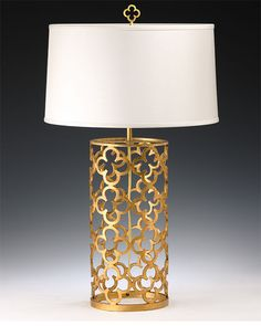 hand-wrought iron table lamp with antique gold leaf finish and round hardback fabric shade; table lamps