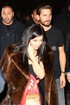 Late night chill: Kylie wore Scott's fur coat over her shoulders to keep warm...