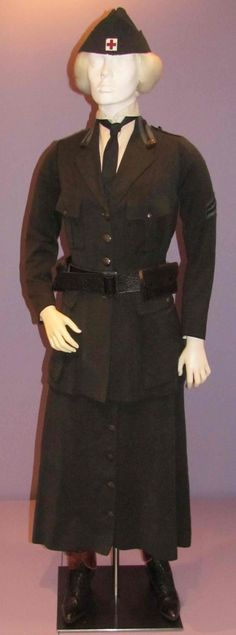 American Red Cross Motor Corps Uniform: Skirt Suit, 1917-18. Wool twill, wool chevrons, metal buttons; cotton shirt. Suit label: Best & Co., New York. The Motor Corps volunteers could elect to wear breeches under the skirts of their suits, but some, according to surviving photos, wore breeches without the proper skirts over them. The wearer of this skirt suit apparently chose to wear only the skirt, as it lacks breeches.   Motor corps volunteers, over 12,000 strong and almost entirely women, ... Under The Skirt, American Red Cross, Classy Casual, Casual Fall Outfits, Historical Clothing, Skirt Suit, New Woman, Fashion Outfits, Women's Fashion