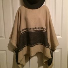 Oversized Pullover Frayed Blanket Poncho Lightweight and soft, perfect for summer nights! Creme with grey design and frayed edging. Has placemat style sewn sleeves. This is super casual and fun to wear. Sweaters Shrugs & Ponchos
