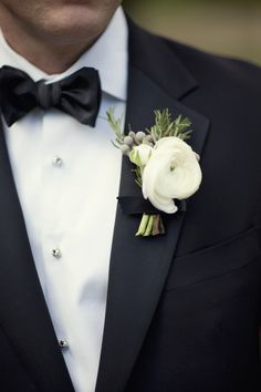 boutonnieres: white ranunculus, rosemary and green leaves wrapped in black ribbon with the stems showing. Ranunculus Boutonniere, White Boutonniere, Groomsmen Boutonniere, Corsage And Boutonniere, Groom And Groomsmen, Boutonnieres, Wedding Boutonniere, Groom Tuxedo, Tuxedo Suit