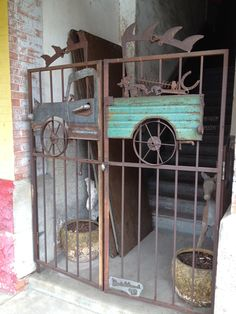 Ornamental metal gate with old truck profile as part of the gate