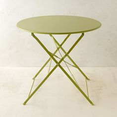 "Our favorite piece for outdoor entertaining, this café style table collapses for easy storage and transport, and comes in a rainbow of complementary hues that are perfect for mixing and matching. Topped with UV-resistant paint, the colors will remain bright and vibrant for years in the garden.- Powdercoated steel- Indoor or outdoor use- Wipe clean with soft cloth and mild, non-abrasive detergent- Imported28""H, 31.5"" diameter"