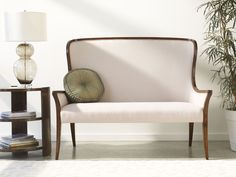 Elegant walnut wingback settee loosely based on a 19th century porter's chair with a high upholstered back and sweeping arms with further upholstered panels, sabre legs to front and back. The original of c.1880. #JonathanCharles #Windsor #Furniture #InteriorDesign #Hpmkt #Decorex