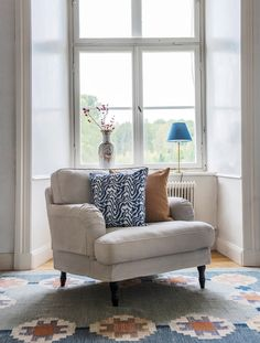Howard armchair   IKEA Stocksund armchair with a Bemz x Romo cover   Elegant windows   patterned rug