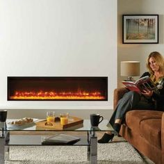 Presented as the frameless Edge, the Gazco Radiance Inset electric fire forms a striking hole-in-the-wall focal point - with its flawless lines and pure vi Electric Fire And Surround, Inset Electric Fires, Wall Mounted Electric Fires, Wall Fires, Beautiful Wall, House Design, Tv Fireplace, Fireplaces, House Ideas