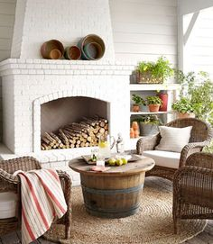 #PinMyDreamBackyard The combination of California weather and a fireplace makes this outdoor living area a year-round hangout in this California home. Wicker chairs from a local shop surround the coffee table, fashioned out of a reclaimed wine barrel. The walls are painted Collonade Gray by Sherwin-Williams, while the fireplace is painted China White by Benjamin Moore.