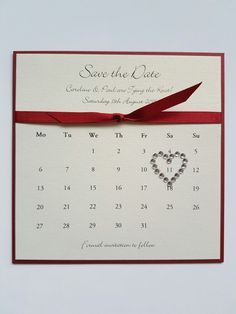 Red and ivory bespoke save the date idea with a calendar theme
