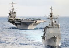 USS Mobile Bay and USS John C. Stennis.