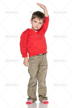 Little boy shows his height ...  alone, boy, caucasian, child, childhood, confident, cute, enjoyment, european, fashion, front, gesture, growth, handsome, height, indoor, isolated, kid, little, people, person, portrait, positive, positivity, red, serious, single, stand, studio, tall, thought, white, young