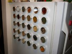 Magnetic spice containers stuck to the fridge - awesome!