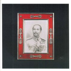 The Fabergé Collection of His Late Majesty King Chulalongkorn of Thailand - a rectangular silver frame with red guilloché enamel, holding a photograph of the King