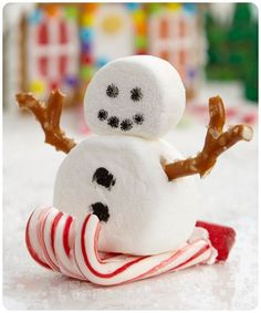Adorable snowman sledding