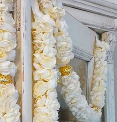White flower garlands with gold beads