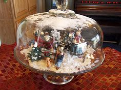 Christmas scene under a snowy cake dome (perfect since I never use mine anyway!)
