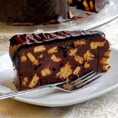 Prince William's Chocolate Biscuit Cake - fit for a Royal! This recipe for chocolate biscuit cake was inspired by the marriage of William & Kate, where this favorite of the royal family was served at the Prince's request as the grooms cake. Chocolate Biscuit Cake, Chocolate Desserts, Decadent Chocolate, Chocolate Ganache, Rock Recipes, Cake Recipes, Dessert Recipes, Food Cakes, Truffles