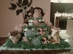 Monkey Safari Cake: To achieve this look I used:  100 size 3 Pampers Cruisers disposable diapers. 1 large stuffed animal for the top-Monkey. 2 medium sized stuffed animals