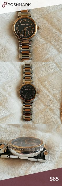 Michael Kors multi tone black face watch Beautiful Michael Kors watch. Crystal accents around outside edge. No scratches on face. Michael Kors Accessories Watches