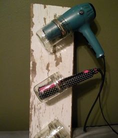 A board and mason jars can be a great way to hold hot hair tools like curling irons and blow dryers.