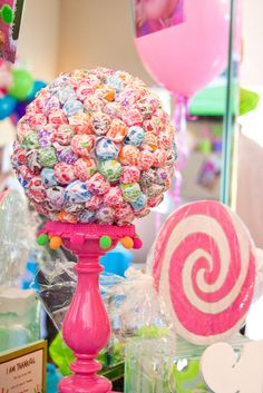 A foam ball from the craft store and a bag a dum dums can make a great center piece for a cheap price. (Good for Candy Land theme)