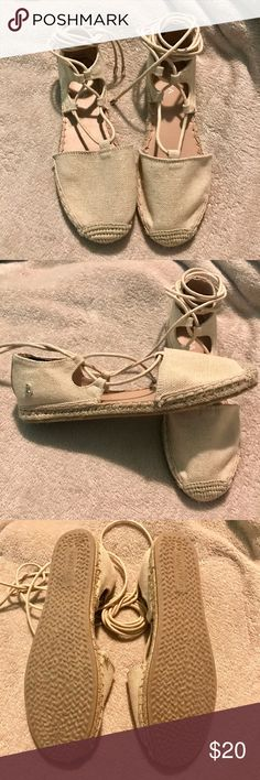 Nautica  Espadrille Flats Brand New Never Worn! Beige color espadrilles with strings that wrap around your legs. Has glitter on the front of the shoe. Only tried them on but i suggest them for someone with narrow feet. The left shoe is coming loose on the sides (see last 2 pictures) Nautica Shoes Espadrilles