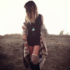 Black fringed mini, turquoise pendant, oversized tribal knit, boots & knee high socks. Cosy boho threads for winter.