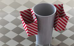 This cup idea was created to carry slidder hamburgers two at a time with a drink....   just think a guy can carry one in each hand and really have a meal....      it was created for the food industry for carring various types of food snacks..