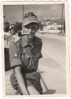 A German GebirgsJager smoking a pipe in what looks like a tropical uniform. Location unknown, date unknown ~ Vengeance_Lord