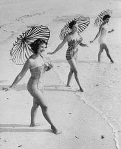 A trio of pretty suits and matching striped umbrellas. #vintage #beach #swimsuits
