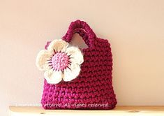 Crochet pattern for girls It is a small purse perfect for your princess little treasures. Crocheted out of super bulky weight yarn in white with pink flower embellishment for added appeal Simply the cutest! Skill level: easy/intermediate Materials: 52 yards of super bulky weight