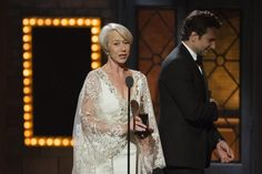 """Actor Bradley Cooper walks away after presenting the award for Best Performance By An Actress In A Leading Role In A Play to Helen Mirren for """"The Audience"""". REUTERS/Lucas Jackson"""